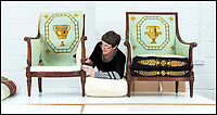 BNPS.co.uk (01202 558833)<br /> Pic: PhilYeomans/BNPS<br /> <br /> Conservator Emma Telford with a restored chair and its part finished pair.<br /> <br /> Seat of Power - The First Duke of Marlborough&rsquo;s campaign chairs, upon which he sat to plot the downfall of the French King Louis XIV, are returning to Blenheim Palace following an 18-month restoration.<br /><br />The chairs would have been carted across Europe as part of the Duke&rsquo;s baggage train to allow him a comfortable seat in which to plan his stunningly successful campaign against the mighty French monarch.<br /><br />Textile conservator Emma Telford, who is based in Herefordshire, had to turn detective to re-discover the ornate 18th century chairs&rsquo; original decoration and recruit a team of embroiders to help bring them back to life.<br /><br />In total Emma and her volunteer helpers used a staggering 10,000 metres of French silk to re-embroider the chairs with the original designs.