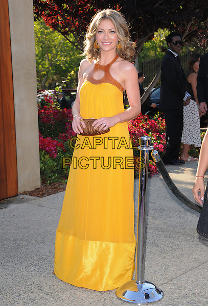 REBCCA GAYHEART .Attending The 7th Annual Chrysalis Butterfly Ball held at a private estate in Brentwood, California, USA,.May 31st 2008                                                                     .full length long yellow dress  maxi bronze purse clutch bag brown.CAP/DVS.©Debbie VanStory/Capital Pictures