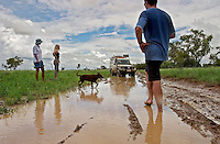 Andrew (center) and Jenny (on left) Hughes try to make it out to their favorite fishing spot, but the tracks are all mucked up this time of year.  These are the most expert 4WD folks I've ever met, but these tracks are just too difficult during the wet season.  Michael Iuretigh is in upper right corner of photo.