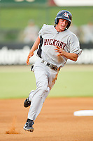 Jonathan Roof #14 of the Hickory Crawdads hustles towards third base against the Kannapolis Intimidators at Fieldcrest Cannon Stadium August 18, 2010, in Kannapolis, North Carolina.  Photo by Brian Westerholt / Four Seam Images