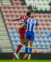 Alex Gilbey of Wigan Athletic & Joel Matip of Liverpool during the pre season friendly match between Wigan Athletic and Liverpool at the DW Stadium, Wigan, England on 14 July 2017. Photo by Andy Rowland.