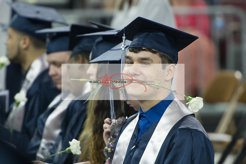 0618<br /> <br /> Eagle River graduate Hunter Terminel holds his graduation rose in his teeth.  Photo for the Star by Michael Dinneen