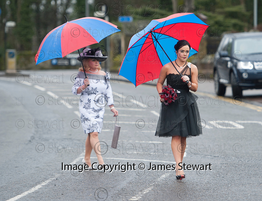 The sister and a woman, believed to be her mother, of Moya Jane Farrell walk the short distance across the road from the accommodation where they were staying.to the Brig O'Doon House Hotel, Alloway, for the wedding of Steven Naismith and Moya Jane Farrell.