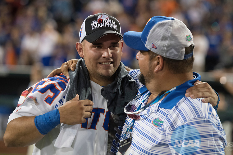 OMAHA, NE - JUNE 27: Mike Rivera (4) of the University of Florida hugs his father after game two of the Division I Men's Baseball Championship held at TD Ameritrade Park on June 27, 2017 in Omaha, Nebraska. The University of Florida defeated Louisiana State University 6-1 in game two of the best of three series. (Photo by Justin Tafoya/NCAA Photos via Getty Images)
