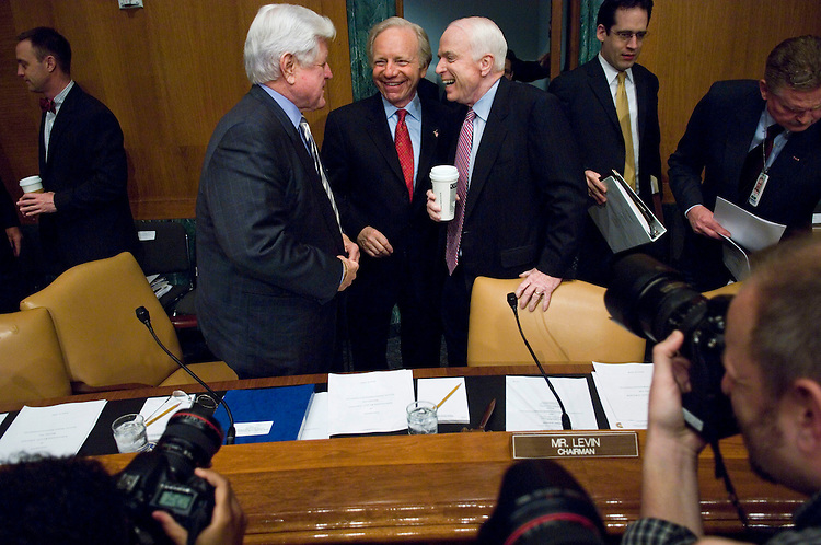 "WASHINGTON, DC - April 08: Sen. Edward M. Kennedy, D-Mass., Sen. Joseph I. Lieberman, D-Conn., and presidential hopeful Sen. John McCain, R-Ariz., talk before Gen. David H. Petraeus, the top U.S. commander in Iraq, and U.S. Ambassador to Iraq Ryan C. Crocker testified during the Senate Armed Services hearing on the situation in Iraq. Petraeus told Congress that he has recommended a halt to troop withdrawals for at least 45 days once the ""surge"" forces added last year depart this summer. If President Bush accepts the recommendation as expected, the number of U.S. troops in Iraq would level off at about 140,000 in July, down from about 156,000 now. After the pause, administration officials will decide if and when withdrawals might continue. (Photo by Scott J. Ferrell/Congressional Quarterly)"