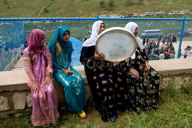 SULAIMANIYAH, IRAQ: Women play traditional Kurdish drum as they participate in the festival. Friday April 30, 2010...This festival is an annual celebration for the followers of Sheikh Qadr Kesnazani, and was held later in the year to coincide with the birth of the prophet Mohammed, and allow for the the celebration to be held outside in Barzinji.  ..Photo by Aram Karim