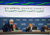 United States President Barack Obama listens while Secretary of State John Kerry assists Mohamed Ould Abdel Aziz, the President of Mauritania, before Session One: Investing in Africa's Future, during the Africa Leaders Summit at the State Department in Washington DC, August 6, 2014. Obama is promoting business relationships between the United States and African countries during the three-day U.S.-Africa Leaders Summit, where 49 heads of state are meeting in Washington.  <br /> Credit: Molly Riley / Pool via CNP