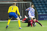 Kilmarnock v St Johnstone...06.12.14   SPFL<br /> Darryl Westlake brings down Michael O'Halloran for a penalty<br /> Picture by Graeme Hart.<br /> Copyright Perthshire Picture Agency<br /> Tel: 01738 623350  Mobile: 07990 594431