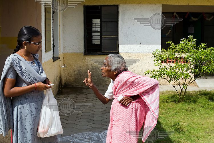 Lakshmi, an elderly resident, scolds a social worker at Tamaraikulum Elders' village. The village is a pioneering experiment initially set up by HelpAge India after the Asian Tsunami to help elderly people displaced by the natural disaster. Today, the village is a self-sustaining community providing a family environment where more able-bodied residents assist the less able-bodied and provides 100 older people with a safe place to live, free healthcare, emotional security, a good diet and professional care and support...