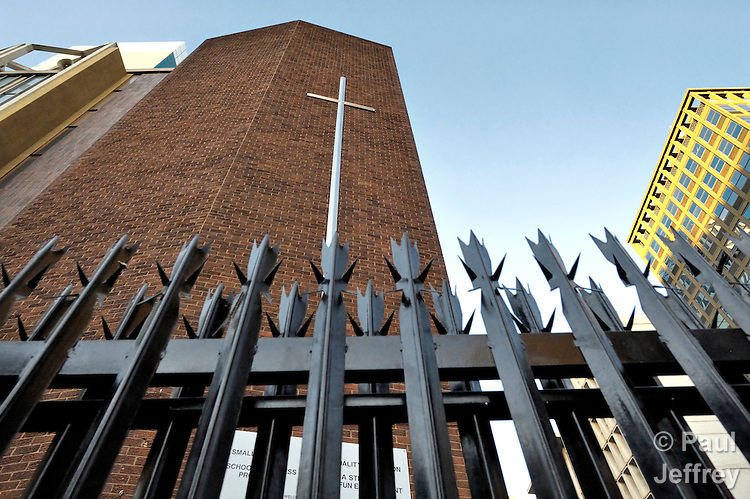 Refugees from Zimbabwe and other African countries have filled the Central Methodist Church in Johannesburg, South Africa, provoking neighboring business owners to erect a fence limiting access to the church. More than 3,000 refugees suffering from economic desperation and sporadic xenophobic attacks live in the church.