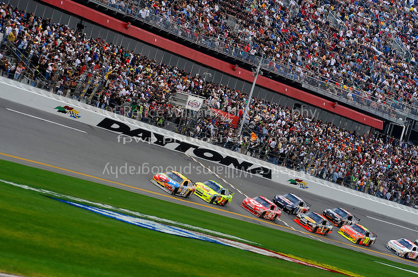 15 February  2009, Daytona Beach, Florida USA.Kyle Busch leads Mark Martin (5) and Juan Pablo Montoya (42)..Daytona International Speedway: Daytona 500.©F. Peirce Williams 2009.F. Peirce Williams.photography
