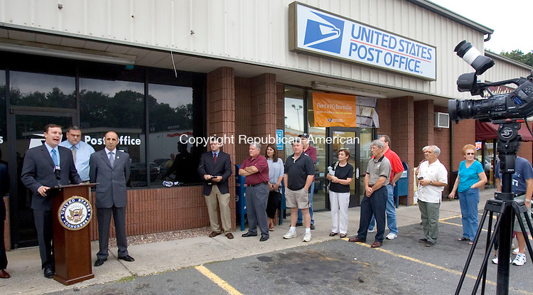 WATERBURY, CT. 25 August 2011-082511SV07--From left, U.S. Rep. Chris Murphy, D-5th, John H. Dirzius, American Postal Workers Union, and State Rep. Selim Noujaim, R-74, hold a press conference at the Post Office on Manor Avenue in Waterbury Thursday. They were there to discuss local impacts of post office closures and layoffs.<br /> Steven Valenti Republican-American