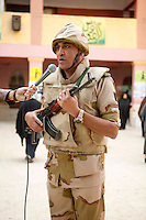 Egypt / Cairo / 22.12.2012 / A soldier is being interviewed in a polling center in Agouza. Egyptians cast their ballots during the second day of the constitutional referendum, December 22nd.  © Giulia Marchi