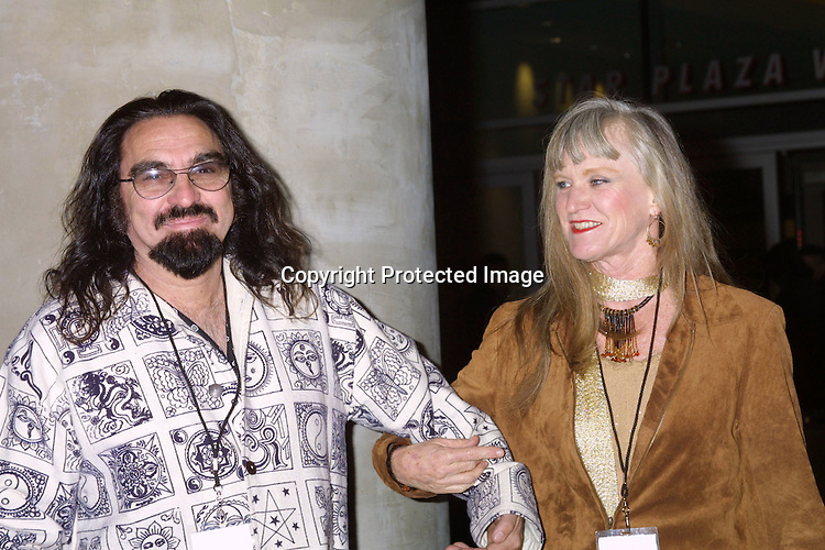 ©2003 KATHY HUTCHINS / HUTCHINS PHOTO.ROLLING STONES IN A FREE CONCERT.TO FIGHT GLOBAL WARMING .EVENT SUPPORTS NRDC.STAPLES CENTER,.LOS ANGELES, CA.FEBRUARY 6, 2003.LEONARDO DICAPRIO'S FATHER AND STEPMOM
