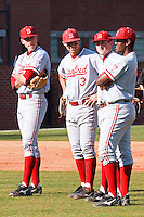 NASHVILLE, TENNESSEE-Feb. 26, 2011:  Infielders Stephen Piscotty, Kenny Diekroeger, Eric Smith and brian Ragira of Stanford chat during a break against Vanderbilt, during a game at Vanderbilt University in Nashville, Tennessee.  Vanderbilt defeated Stanford 8-7.