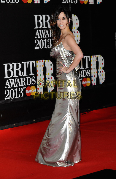 Berenice Marlohe.The Brit Awards 2013 - Arrivals, held at The O2 Arena, London, UK, 20th February 2013..brits full length shiny silver dress long maxi hand on hip ruched  side .CAP/DH.©David Hitchens/Capital Pictures.