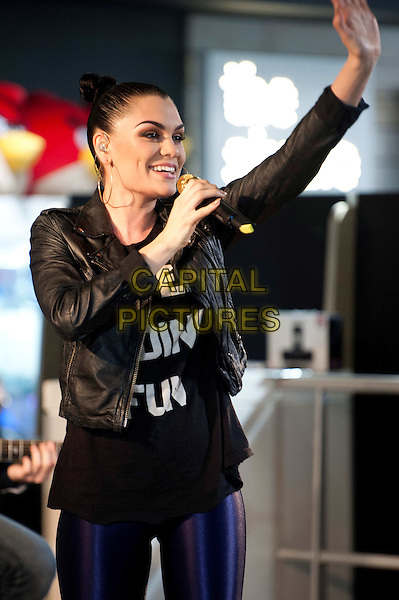 Jessie J (Jessica Ellen Cornish) on stage for the first in a series of events as part of the Music is GREAT week, HMV Oxford Circus, London, England..May 14th, 2012.in concert live gig performance performing half length singing black arm in air leather jacket hoop earrings gold hair up bun.CAP/BF.©Bob Fidgeon/Capital Pictures.