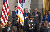 From left to right: Speaker of the United States House of Representatives Paul Ryan (Republican of Wisconsin), US Senate Majority Leader Mitch McConnell (Republican of Kentucky), US Senate Minority Leader Chuck Schumer (Democrat of New York) and US House Minority Leader Nancy Pelosi (Democrat of California) stand for the National Anthem at a Congressional Gold Medal ceremony honoring former US Senator Bob Dole (Republican of Kansas) that was also attended by US President Donald J. Trump in the Rotunda of the US Capitol on Wednesday, January 17, 2017.  Congress commissioned gold medals as its highest expression of national appreciation for distinguished achievements and contributions.  Dole served in Congress from 1961 through 1996, was the Senate GOP leader from 1985 through 1996, and was the 1996 Republican Party nominee for President of the United States.<br /> Credit: Ron Sachs / CNP