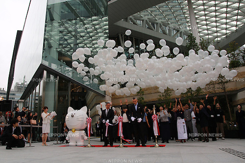 Tokyo, Japan – (L to R) The mascot of the complex Toranomon, the President and CEO Tsuji Shingo, the General manager, Andaz Tokyo Toranomon Hills Arnaud de Saint-Exupéry and staff attend the opening ceremony of the Toranomon Hills building on June 11, 2014. The building has 52 floors which include commercial stores, offices, privates residences and the Andaz Tokyo Toranomon Hills hotel from the 47 to the 52 floor. Its located in the Toranomon district and is the second talles building in Tokyo after Midtown Tower. (Photo by Rodrigo Reyes Marin/AFLO)