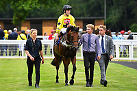Winner of The Bathwick Tyres EBF Novice Stakes,Beringer ridden by Finley Marsh and trained by Alan King is led into the winners enclosure during Ladies Evening Racing at Salisbury Racecourse on 15th July 2017