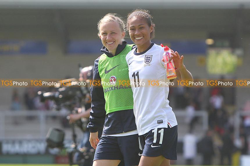 Rachel Yankey (R) leaves the field after winning her record 126th cap for England - England Women vs Japan Women - Friendly Football International at the Pirelli Stadium, Burton Albion FC - 26/06/13 - MANDATORY CREDIT: Gavin Ellis/TGSPHOTO - Self billing applies where appropriate - 0845 094 6026 - contact@tgsphoto.co.uk - NO UNPAID USE
