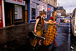 'CLAN, THE' SCOTLAND, A GROUP WHO SPEND THEIR WEEKENDS AT A CAMP IN GLEN CROE RECREATING THE LIFE OF A SCOTTISH CLAN BEFORE THE DEFEAT OF BONNIE PRINCE CHARLIE BY THE ENGLISH AT THE BATTLE OF CULLODEN IN 1746. THE MANDOLIN PLAYING BUSKER, 'BLIN(D) HARY', IS HELPED ACROSS THE STREET IN GLASGOW BY THE CHIEF SEORAS. HIS BLINDNESS HE SAYS IS A GIFT NOT A HANDICAP., 1989