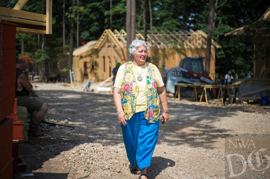 NWA Democrat-Gazette/CHARLIE KAIJO Kimberly Clark, who helped organize volunteers, for a tiny home construction project, walks through the site, Friday, June 8, 2018 on Passion Play Road, across the street from the Washington Regional clinic in Eureka Springs. <br />