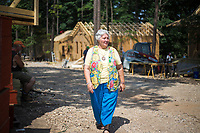 NWA Democrat-Gazette/CHARLIE KAIJO Kimberly Clark, who helped organize volunteers, for a tiny home construction project, walks through the site, Friday, June 8, 2018 on Passion Play Road, across the street from the Washington Regional clinic in Eureka Springs. <br /><br />Eight tiny houses are being built in Eureka Springs, which has a dearth of affordable housing. They're being constructed by 66 volunteers from 13 states with World Mission Builders. They began work on Monday (June 4) and should finish most of the construction by the end of next week (June 15). Then local volunteers will finish out the interiors and put shingles on the roofs. The first eight houses are part of what will be called ECHO Village. Plans are to eventually have 26 houses in the village. It's a project of Eureka Christian Health Outreach, which bought 10 acres for the village. The same group started ECHO Clinic in Eureka Springs in 2005. It provides free medical care to the uninsured and people on a low income.