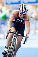 12 JUL 2014 - HAMBURG, GER - Jodie Stimpson (GBR) from Great Britain begins her final bike lap during the elite women's 2014 ITU World Triathlon Series round in the Altstadt Quarter of Hamburg, Germany (PHOTO COPYRIGHT © 2014 NIGEL FARROW, ALL RIGHTS RESERVED)