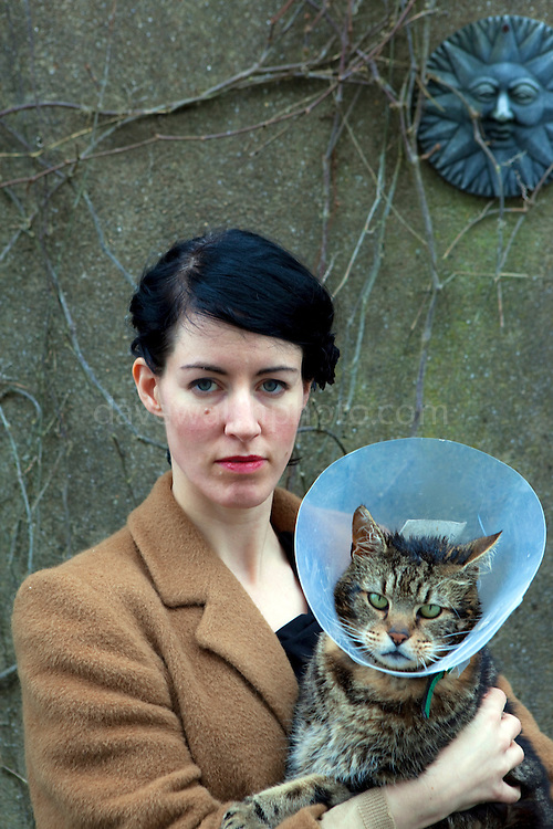 Suzanne Walsh and Mr Crowley, Christmas Day, 2011. Note the grey sky, with some sunshine. Crowley's wearing the collar due to injuries sustained two months beforehand, when an unknown assailant threw boiling water over him.