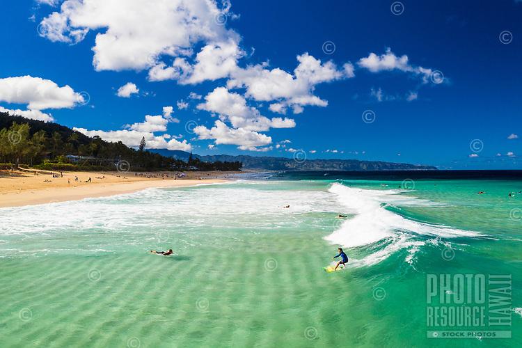 Aerial view of sandbars, surfers and the 'Ehukai coastline in Pupukea along O'ahu's North Shore.