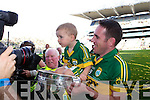 Declan O'Sullivan with son Ollie after defeating Donegal in the GAA All Ireland Senior Football Championship final.