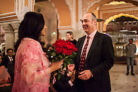 Australia's High Commissioner to India, Dr. Lachlan Strahan (right) presents Princess Diya Kumari of the Royal Family of Jaipur (left) with a bouquet of flowers at the OzFest Gala Dinner in the Jaipur City Palace, in Rajasthan, India on 10 January 2013. Photo by Suzanne Lee