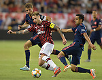 Bayern Munich players Thomas Muller (25, left) and Sarpreet Singh (42, right) double-team Lucas Biglia (20) of Milan during their International Champions Cup match on July 23, 2019 at Children's Mercy Park in Kansas City, KS.<br /> Tim VIZER/AFP
