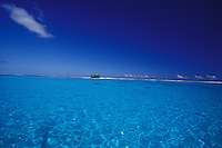 Tropical island in clear blue waters of sandy lagoon, Moorea, French Polynesia