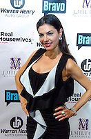 Adriana De Moura attends Real Housewives of Miami Season 3 VIP Premiere Party, at Lou La Vie, Miami, FL, on August 6, 2013