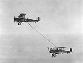 Refueling in mid-air by Captain Lowell H. Smith and Lieutenant John P. Richter, at Rockwell Field, California, June 1923.  They stayed in the air 4 days.  DeHaviland airplanes were used..Credit: U.S. Air Force via CNP