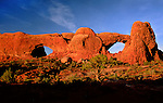 The Spectacles rock formation turn orange in the glow of sunset, Windows area, Arches National Park, Utah