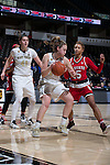 Alex Sharp (14) of the Wake Forest Demon Deacons is guarded by Lucky Rudd (15) of the North Carolina State Wolfpack during first half action at the LJVM Coliseum on January 8, 2017 in Winston-Salem, North Carolina.  The Wolfpack defeated the Demon Deacons 65-50.  (Brian Westerholt/Sports On Film)