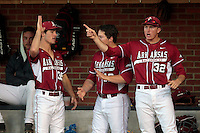 Arkansas players celebrate a play during the game against Virginia Saturday night at Davenport Field in Charlottesville, VA. Photo/The Daily Progress/Andrew Shurtleff