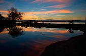 Sunset over Lake Taupo and the Tauranga Taupo river mouth, Lake Taupo, North Island, New Zealand