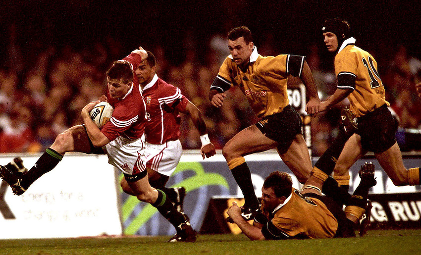 Photo. Richard Lane. .Lions Tour 2001. First Test, Australia v The Lions at the Gabba, Brisbane, Australia. 30/6/2001.Man of The Match, Brian O'Driscoll leaves the Australia defence in his wake.
