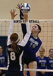 Marymount's Hannah Steger attacks the ball during a college volleyball match against  PSU Harrisburg at Marymount University in Arlington, Vir., on Wednesday, Oct. 9, 2013.<br /> Photo by Cathleen Allison