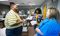 NWA Democrat-Gazette/BEN GOFF @NWABENGOFF<br /> Frederick Thrower (from left), a math teacher at Fort Smith Northside, wife Lynette Thrower, who is completing her teacher certification, and Tonya Martin, a teacher at Parson Hills Elementary in Springdale, work on a group exercise Tuesday, July 9, 2019, during the Empowering  Entrepreneurship Education workshop at the University of Arkansas Global Campus in Rogers.
