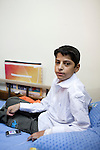 A young cancer patient sits on his bed at a hospital in Medical City on Sunday, October 24, 2010 in Baghdad, Iraq.