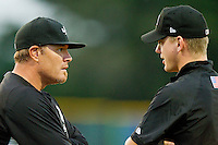 Bristol White Sox manager Pete Rose #14 discusses a call with base umpire Ryan Wills during the Appalachian League game against the Burlington Royals at Burlington Athletic Park on July 6, 2012 in Burlington, North Carolina.  The Royals defeated the White Sox 5-2.  (Brian Westerholt/Four Seam Images)