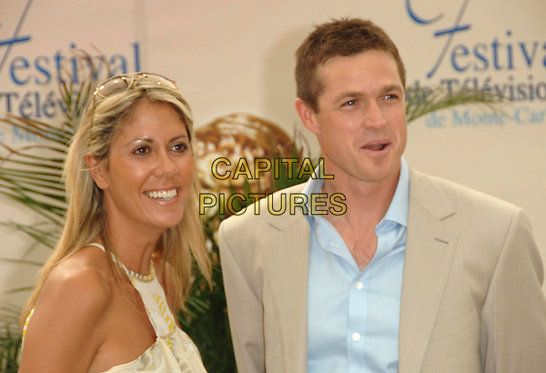 "RACHEL BOURLIER & ERIC CLOSE .attends a photocall promoting the television series ""FBI Port's Disparus (Without A Trace)"" on the third day of the 2008 Monte Carlo Television Festival held at Grimaldi Forum in Monte Carlo, Principality of Monaco, .June 10, 2008..half length blue shirt beige suit jacket.CAP/TTL .©TTL/Capital Pictures"