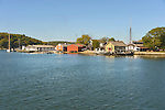 Mystic Seaport and historic 19th century village museum. Shoreline boathouse. Mystic River Harbor