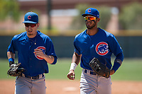 Chicago Cubs outfielders Ruben Reyes (29) and Jose Gonzalez (21) jog off the field between innings of an Extended Spring Training game against the Colorado Rockies at Sloan Park on April 17, 2018 in Mesa, Arizona. (Zachary Lucy/Four Seam Images)