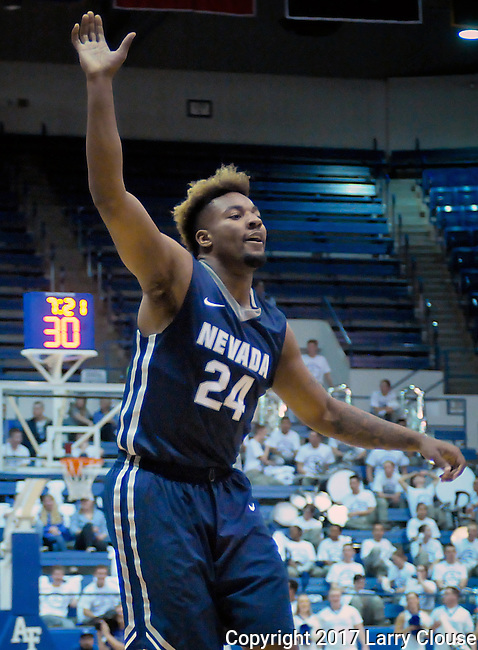 February 15, 2017:  Nevada forward, Jordan Caroline #24, calls for an inbound pass during the NCAA basketball game between the University of Nevada Wolfpack and the Air Force Academy Falcons, Clune Arena, U.S. Air Force Academy, Colorado Springs, Colorado.  Nevada defeats Air Force 78-59.